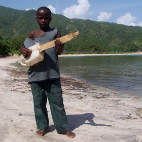Haitian Beach - Boy with jug guitar